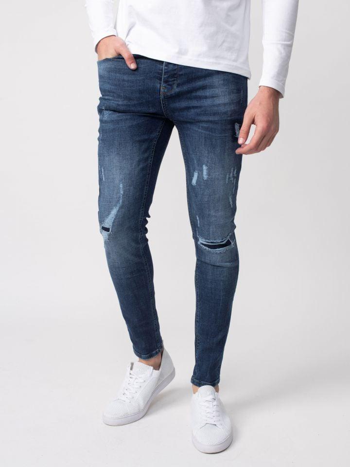 ג`ינס סופר סקיני עם לולאת חגורה רקומה