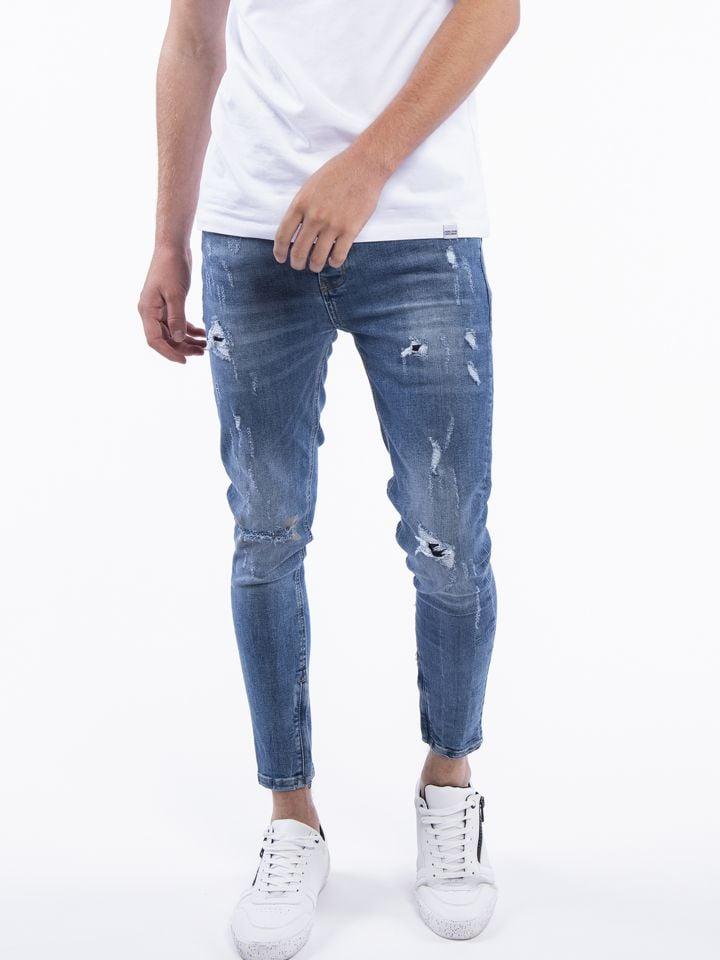 ג`ינס משופשף עם קרעים