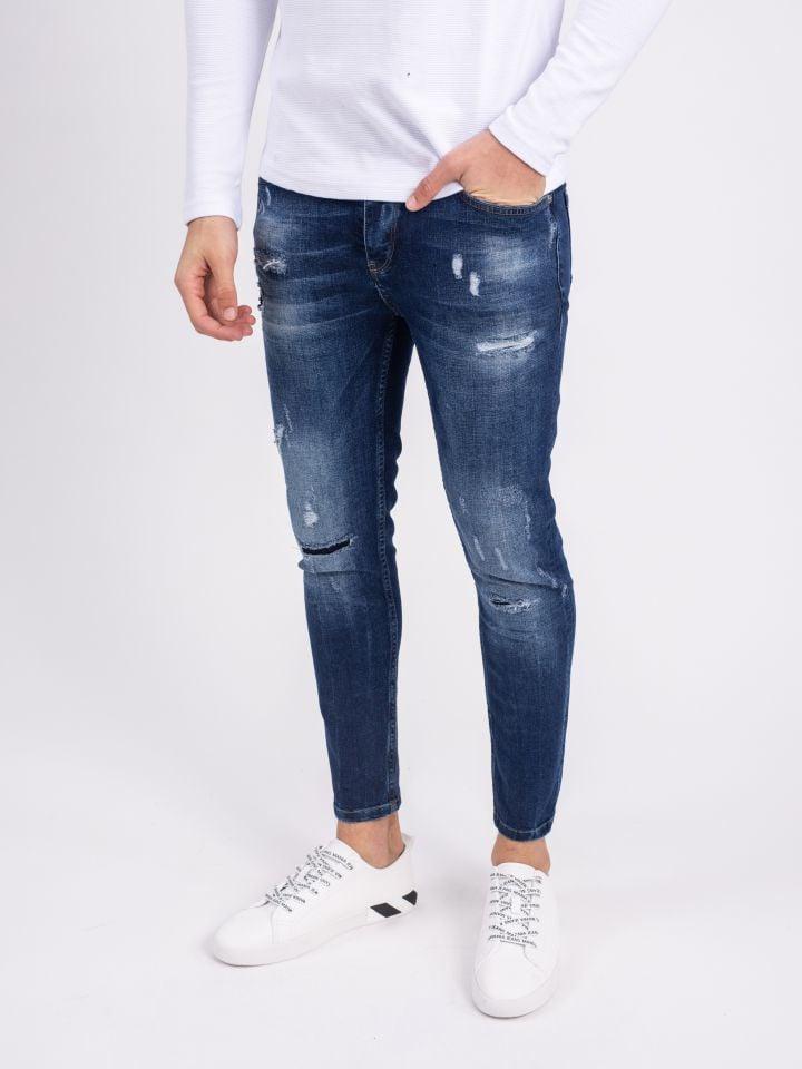 ג`ינס סופר סקיני עם מיתוג מתכתי על לולאת החגורה