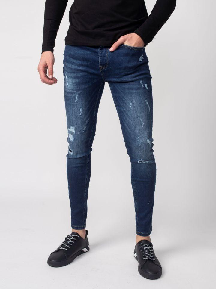 ג`ינס סופר סקיני עם קרעים אטומים