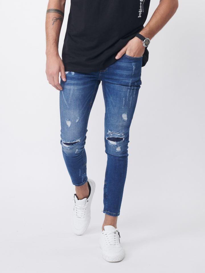 ג'ינס עם אפקט שטיפה וקרעים אטומים