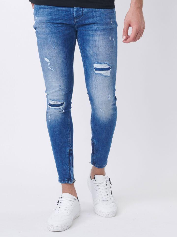 ג`ינס סקיני עם רוכסנים בקרסול