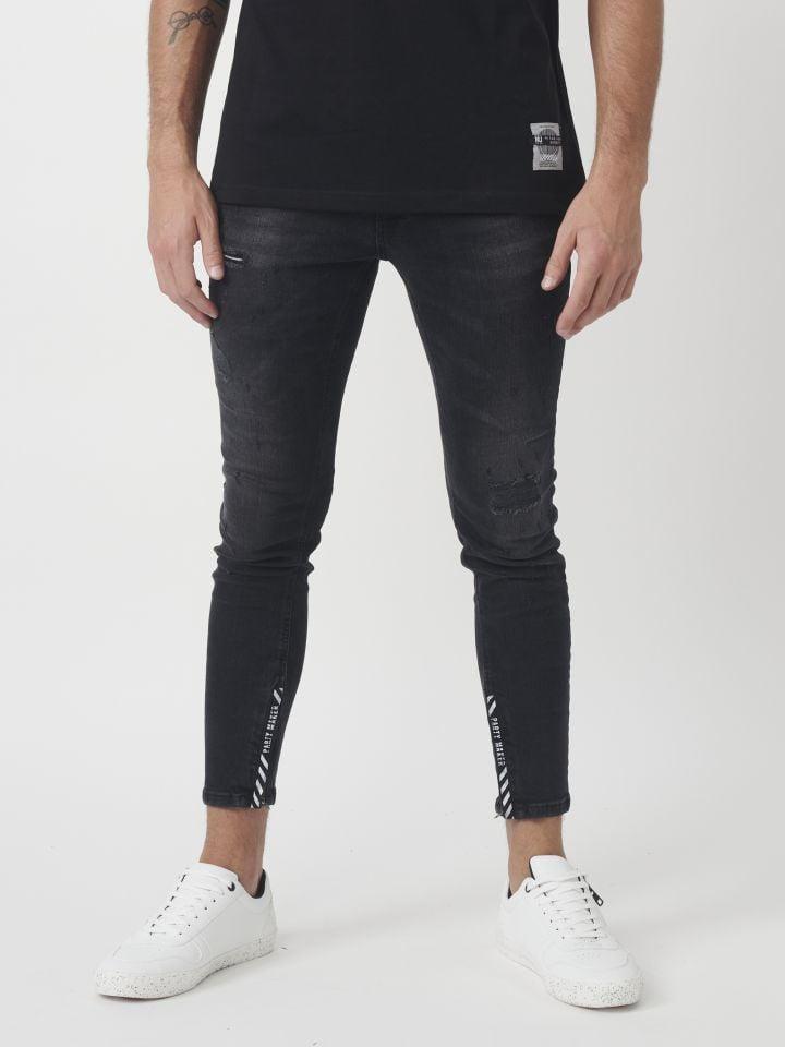 ג`ינס עם רוכסן בקרסול