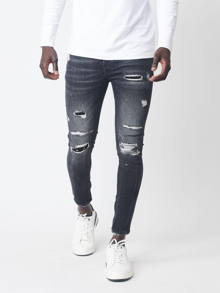 ג`ינס סקיני עם קרעים אטומים