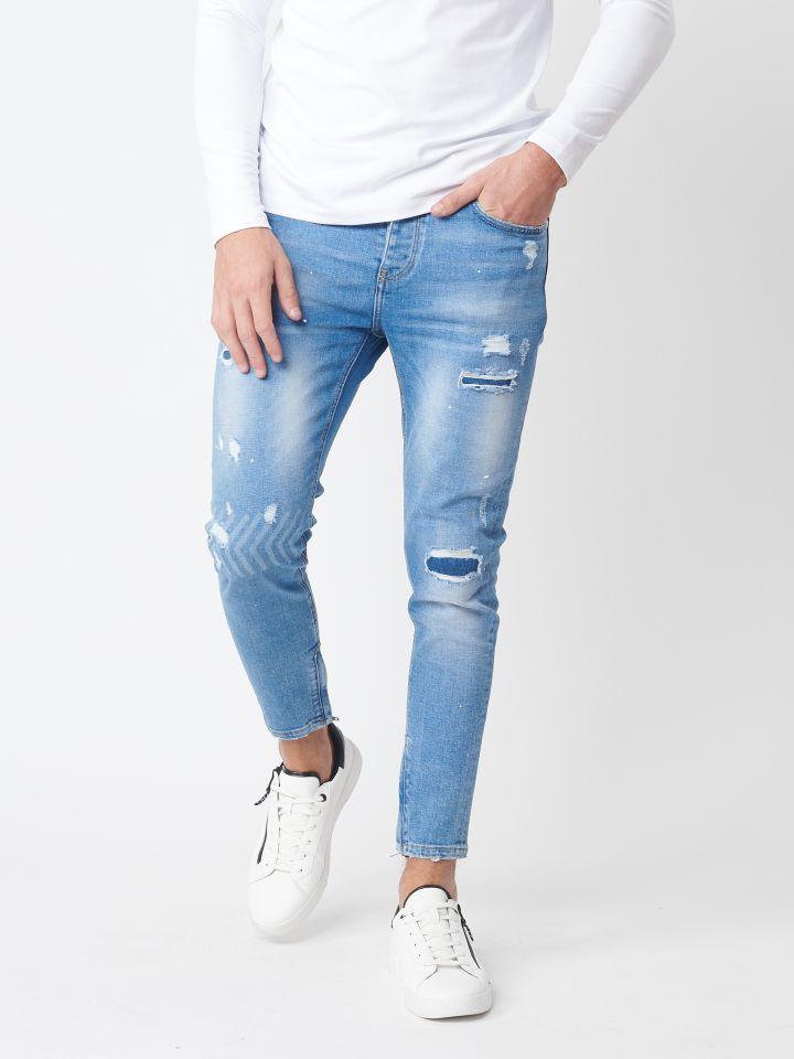 ג`ינס סופר סקיני עם אפקט שטיפה וקרעים אטומים