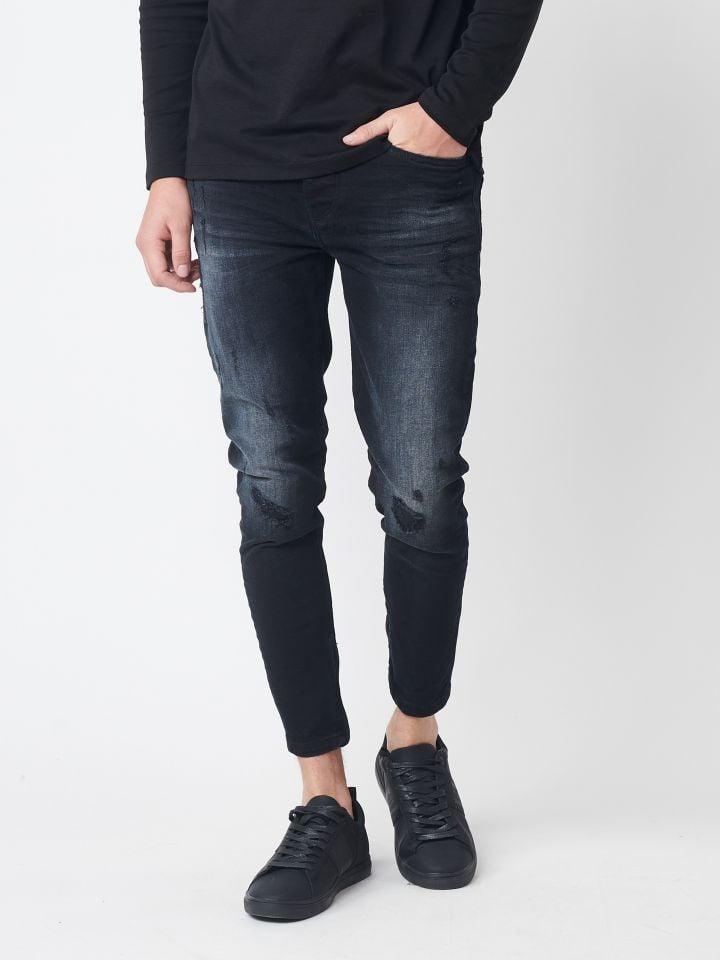 ג`ינס סקיני עם קרעים אטומים וטלאי בד